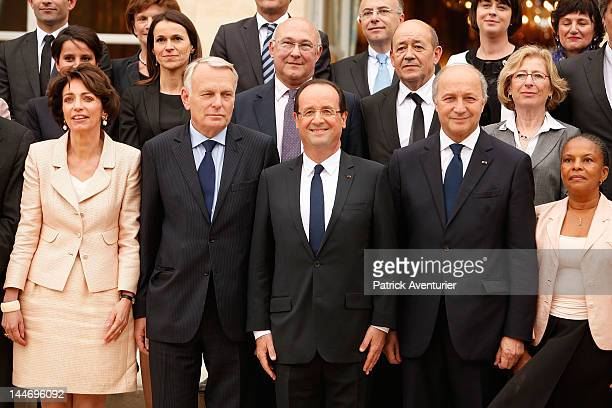 French President Francois Hollande Prime Minister JeanMarc Ayrault and Foreign Minister Laurent Fabius pose with the new cabinet after the first...