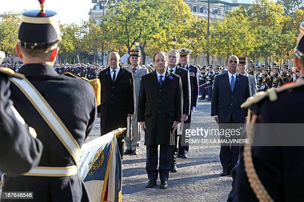 French President Francois Hollande Prime minister JeanMarc Ayrault Defence minister JeanYves Le Drian and Junior minister for Veterans Kader Arif...