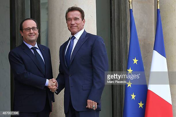 French President Francois Hollande receives Arnold Schwarzenegger at Elysee Palace on October 10 2014 in Paris France