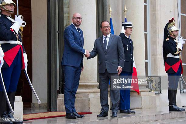 French President, Francois Hollande receives the Prime Minister of Belgium, Charles Michel at Elysee Palace on August 24, 2015 in Paris, France....