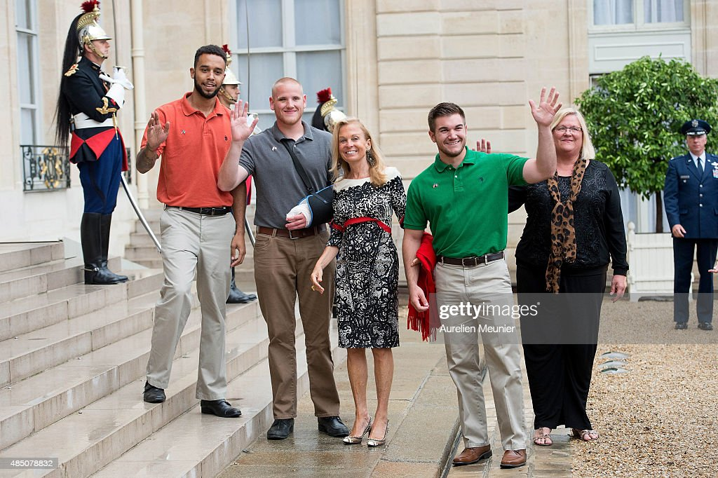 French President, Francois Hollande receives US-France Ambassador, Jane Hartley (C) and honorees at Elysee Palace on August 24, 2015 in Paris, France. Spencer Stone (2L), Anthony Sadler (L) and Alek Skarlatos (R) are being awarded the Legion d'Honneur after overpowering the gunman, 25-year-old Moroccan, Ayoub El-Khazzani, on board a high-speed train after he opened fire on a Thalys train travelling from Amsterdam to Paris. El-Khazzani, who had a Kalashnikov, an automatic pistol and a box cutter, was arrested when the train stopped at the French town of Arras.