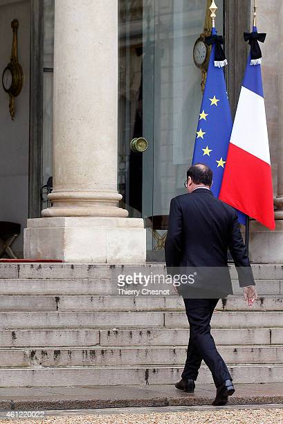French President Francois Hollande returns to the presidential Elysee palace after holding a crisis meeting with French prefects at the Interior...