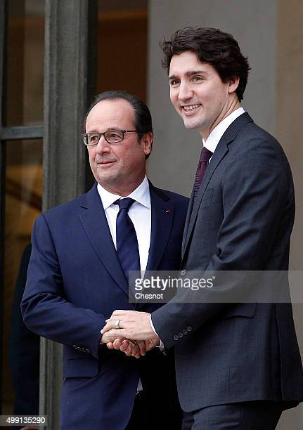 French President Francois Hollande shakes hand with Canadian Prime minister, Justin Trudeau after a meeting at the Elysee Presidential Palace on...