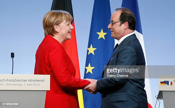 French President Francois Hollande shakes hand with German Chancellor Angela Merkel after a press conference during the 18th FrancoGerman cabinet...