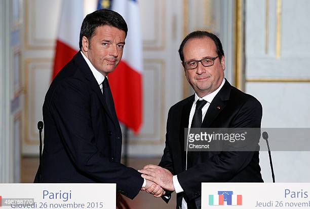 French President Francois Hollande shakes hand with Italian Prime Minister Matteo Renzi after a press conference at the Elysee Presidential Palace on...