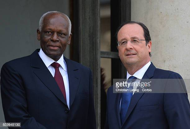 French President Francois Hollande shakes hands with Angola's President Jose Eduardo Dos Santos at the the Elysee presidential palace on April 29 in...