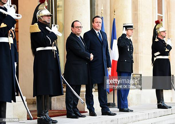 French President Francois Hollande shakes hands with British Prime Minister David Cameron on November 23 2015 at the Elysee Presidential Palace in...
