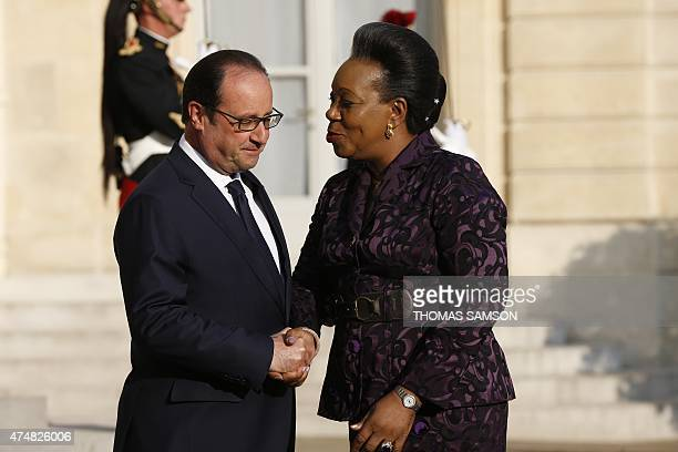 French President Francois Hollande shakes hands with Central African Republic interim president Catherine SambaPanza prior to a meeting at the Elysee...