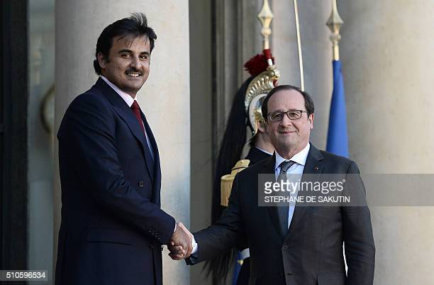French President Francois Hollande shakes hands with Emir of Qatar Sheikh Tamim bin Hamad alThani upon his arrival on February 16 2016 at the Elysee...
