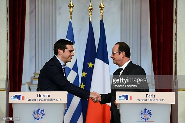 French President Francois Hollande shakes hands with Greece's Prime Minister Alexis Tsipras after their speech at Elysee Palace on February 4 2015 in...