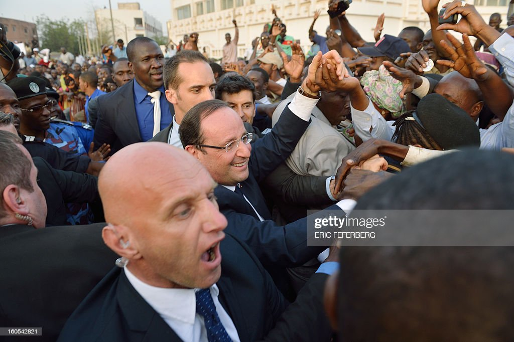 French President Francois Hollande shakes hands with people after delivering a speech on February 2, 2013 in Bamako. Hollande called on Africans to take over the fight against extremism as he received a rapturous welcome today in Mali, where a French-led offensive has driven back Islamist rebels from the north.