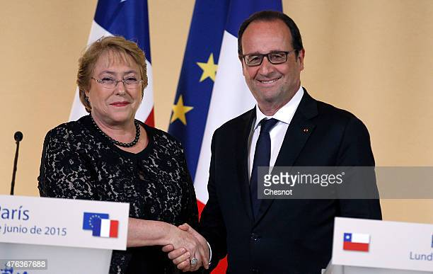 French President Francois Hollande shakes hands with President of Chile Michelle Bachelet after their press conference at the Elysee Palace on June...