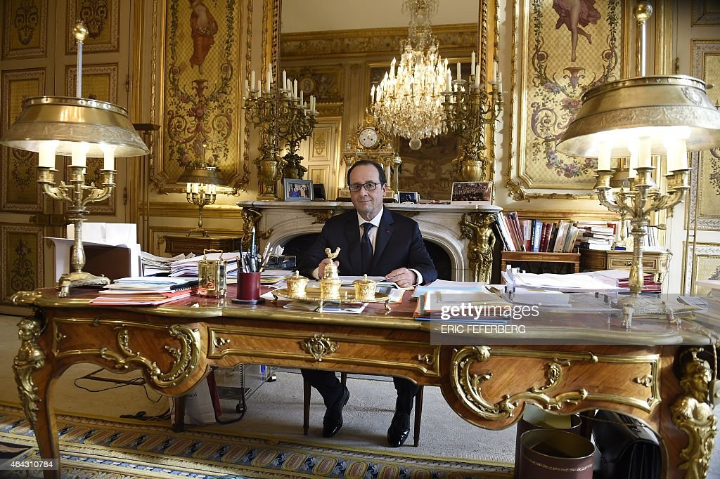 French President Francois Hollande Sits At His Desk In His Office In The  Elysee Palace On