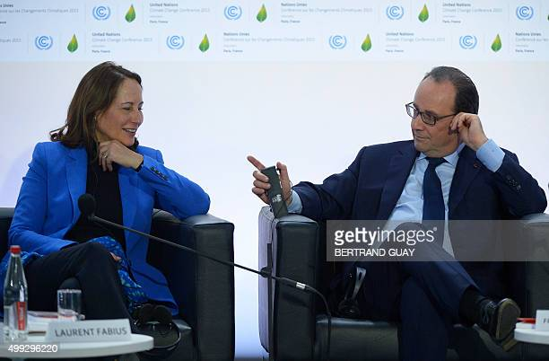 French President Francois Hollande sits next to French Minister of Ecology, Sustainable Development and Energy Segolene Royal during the COP21 World...