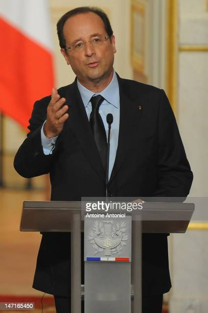 French President Francois Hollande speaks during a news conference with Aung San Suu Kyi at Elysee Palace on June 26 2012 in Paris France Burmese...