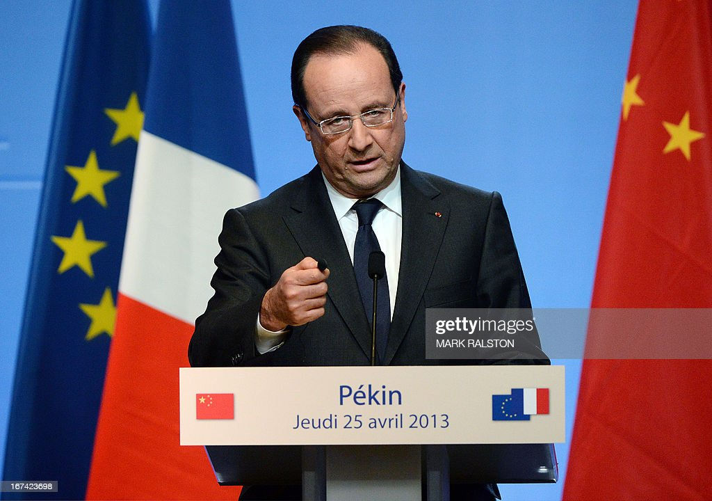 French President Francois Hollande speaks during a press conference at the Four Seasons Hotel in Beijing on April 25, 2013. French President Francois Hollande, accompanied by a high-powered business delegation, started a two-day visit to China, with trade rather than geopolitics at the top of the agenda. For Hollande, beset by economic woes and the aftermath of a damaging corruption scandal that forced his budget minister to resign, it will be a welcome break from his domestic troubles. AFP PHOTO/Mark RALSTON