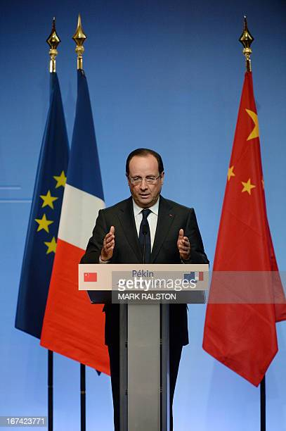 French President Francois Hollande speaks during a press conference at the Four Seasons Hotel in Beijing on April 25 2013 French President Francois...
