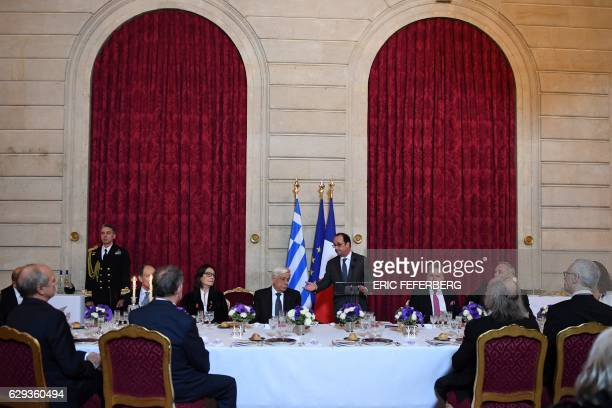 French President Francois Hollande speaks next to Greek President Prokopis Pavlopoulos and Greek singer Nana Mouskouri on December 12 2016 during a...