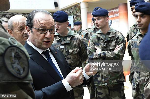 French President Francois Hollande speaks to young soldiers as he visits the military school of SaintCyrCoëtquidan in Guer before delivering New...