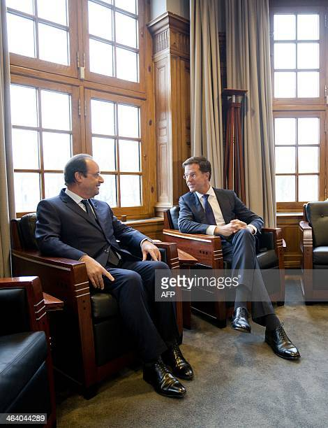 French President Francois Hollande speaks with Dutch Prime Minister Mark Rutte at the Parliament building in The Hague, on January 20, 2014. AFP...