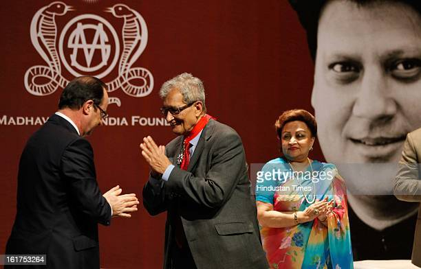 French President Francois Hollande speaks with Indian Nobel laureate Amartya Sen as wife of late Madhavrao Scindia Madhavi Raje Scindia looks on...