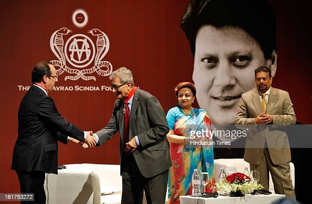 French President Francois Hollande speaks with Indian Nobel laureate Amartya Sen as wife of late Madhavrao Scindia Madhavi Raje Scindia and Vir...