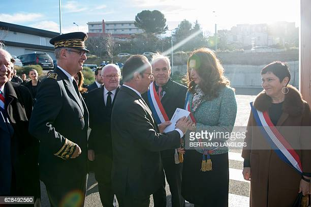 French President Francois Hollande speaks with LR deputy Valerie Boyer as he arrives at the L2 Clerissy tecnical centre to inaugurate the L2 East new...