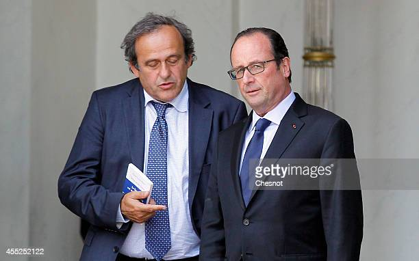 French President Francois Hollande speaks with UEFA President Michel Platini after a lunch for the UEFA EURO 2016 launch at the Elysee Palace on...