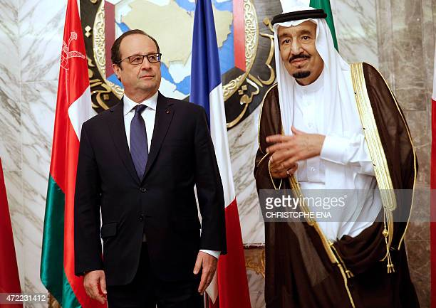 French President Francois Hollande stands beside Saudi Arabias King Salmane ben Abdelaziz Al Saoud during the the Gulf cooperation council summit in...