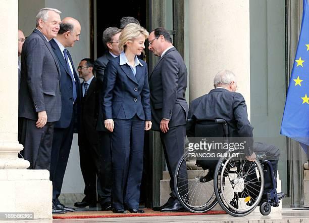 French President Francois Hollande stands next to German Social Affairs minister Ursula von der Leyen , German Finance Minister Wolfgang Schaeuble ,...