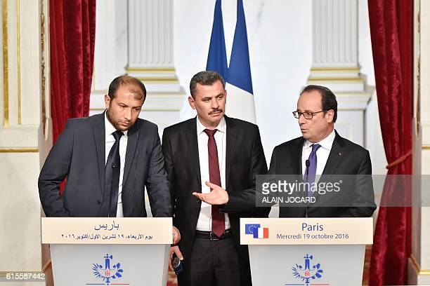 French President Francois Hollande Syria's White Helmets leader Raed Saleh and Hagi Hasan Brita president of the civil committee of Aleppo take part...