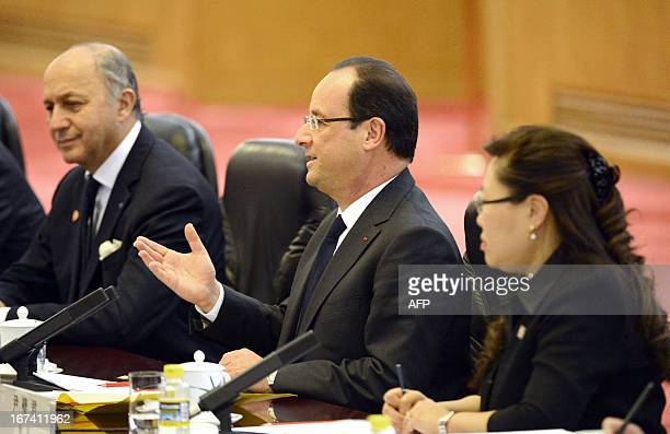 French President Francois Hollande talks to Chinese President Xi Jinping during a meeting at the Great Hall of the People in Beijing on April 25 2013...