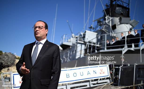"French President Francois Hollande talks to journalists after he visits the French military patrol boat ""Commandant Bouan"" on November 12, 2015 on..."
