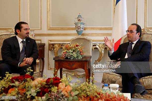 French President Francois Hollande talks with former Lebanese prime minister Saad Hariri during a meeting in Riyadh on May 5 2015 Hollande is the...