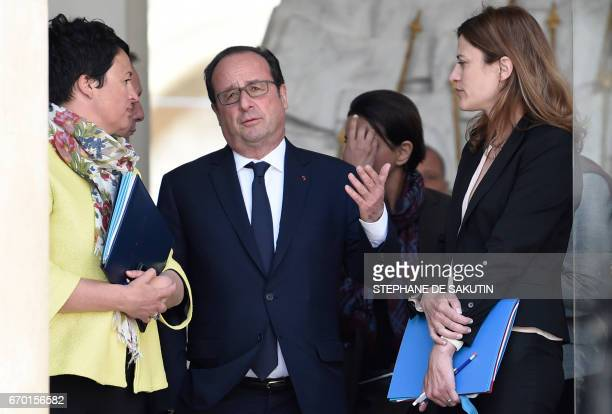 French President Francois Hollande talks with French Junior Minister for Victims Aid Juliette Meadel and French Junior Minister for Local Authorities...