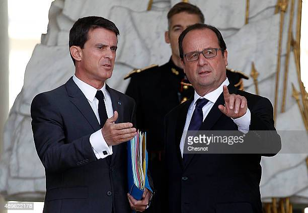 French President Francois Hollande talks with French Prime Minister Manuel Valls after the Cabinet Meeting at the Elysee Palace on September 23 2015...