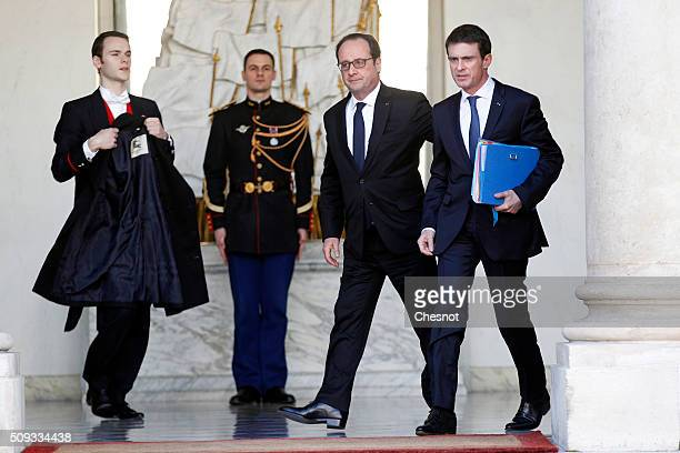 French President Francois Hollande talks with French Prime Minister Manuel Valls after the weekly cabinet meeting at the Elysee Palace on February 10...