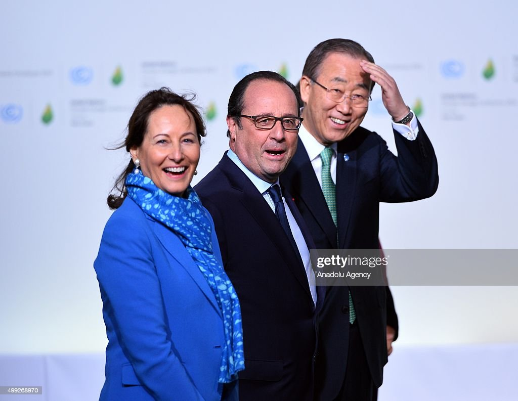 French President Francois Hollande (C), UN Secretary General Ban Ki-moon (R) and French Minister of Ecology, Sustainable Development and Energy Segolene Royal (L) wait for the leaders' arrival for the COP21, United Nations Conference on Climate Change, in Le Bourget, outside Paris, France, on November 30, 2015.