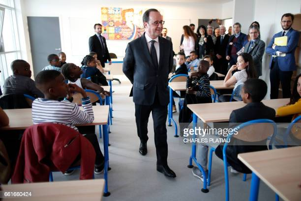 French President Francois Hollande visits a classroom at the Anatole France school in Sarcelles near Paris France March 31 as part of a visit on...