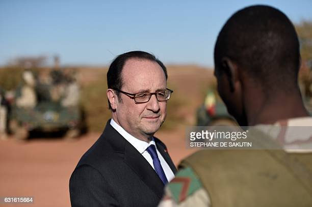 French President Francois Hollande visits troops of France's Barkhane counter-terrorism operation in Africa's Sahel region in Gao, northern Mali on...