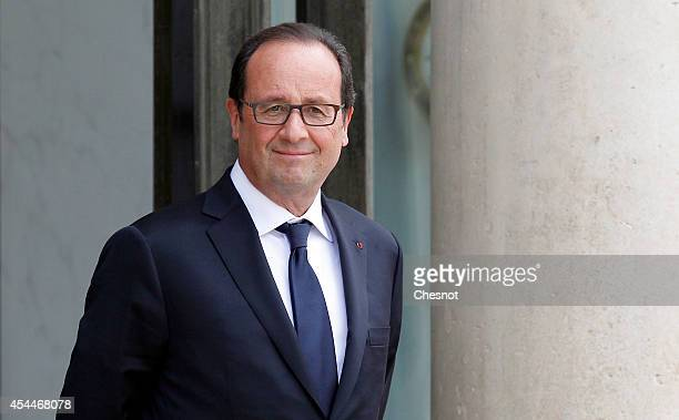French President Francois Hollande waits before his meeting with President of the European Central Bank Mario Draghi at the Elysee palace on...