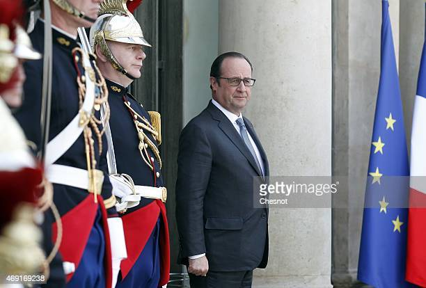 French President Francois Hollande waits for a meeting with Indian Prime Minister Narendra Modi at the Elysee Palace on April 10, 2015 in Paris,...