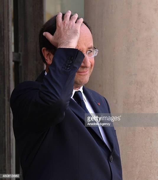 French President Francois Hollande waits for Saudi Arabian Prince Meteb bin Abdullah bin Abdulaziz Minister of the National Guard prior to their...