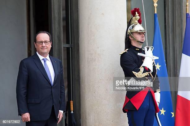 French President Francois Hollande waits for Saudi Prince AlWaleed bin Talal bin Abdulaziz Al Saoud for a meeting at the Elysee Palace on September 8...