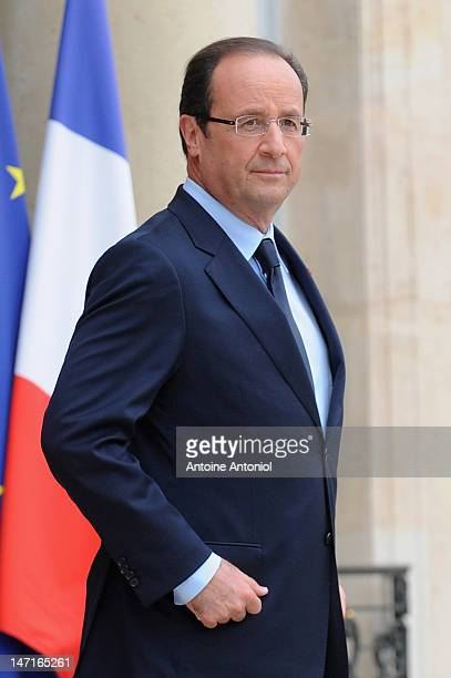French President Francois Hollande waits for the arrival of Aung San Suu Kyi at Elysee Palace on June 26 2012 in Paris France Burmese opposition...