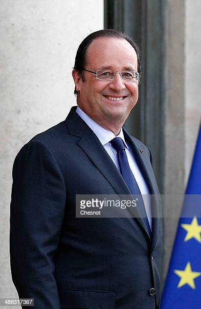 French President Francois Hollande waits Japan's Prime Minister Shinzo Abe prior a dinner at the Elysee palace on May 5 2014 in Paris France French...