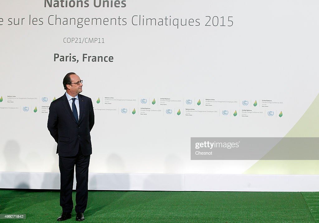French president Francois Hollande waits prior to the arrivals for the opening of the UN conference on climate change, on November 30, 2015 at Le Bourget, France. More than 150 world leaders are meeting for the 21st Session of the Conference of the Parties to the United Nations Framework Convention on Climate Change (COP21/CMP11), from November 30 to December 11, 2015