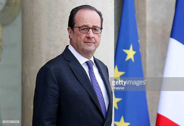 French President Francois Hollande waits Quebec Premier Philippe Couillard prior their meeting at the Elysee presidential Palace on November 23 2016...