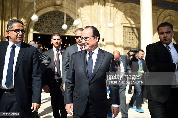 French President Francois Hollande walks alongside Egypt's Antiquities Minister Khaled alAnani during a visit at the Mohamed Ali Mosque at the...