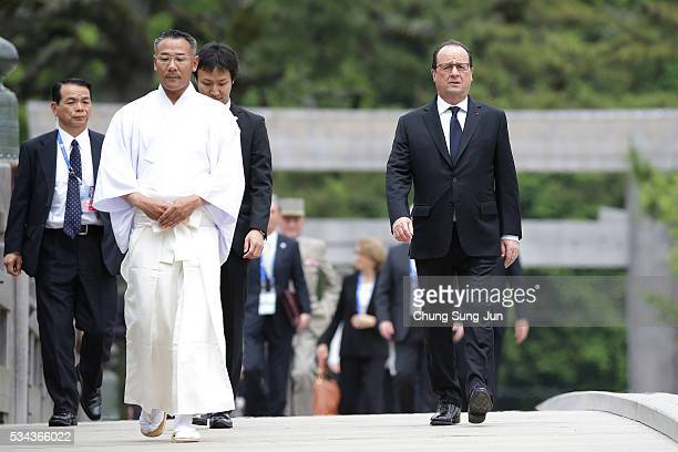 French President Francois Hollande walks on the Ujibashi bridge as he visits at the IseJingu Shrine on May 26 2016 in Ise Japan In the twoday summit...